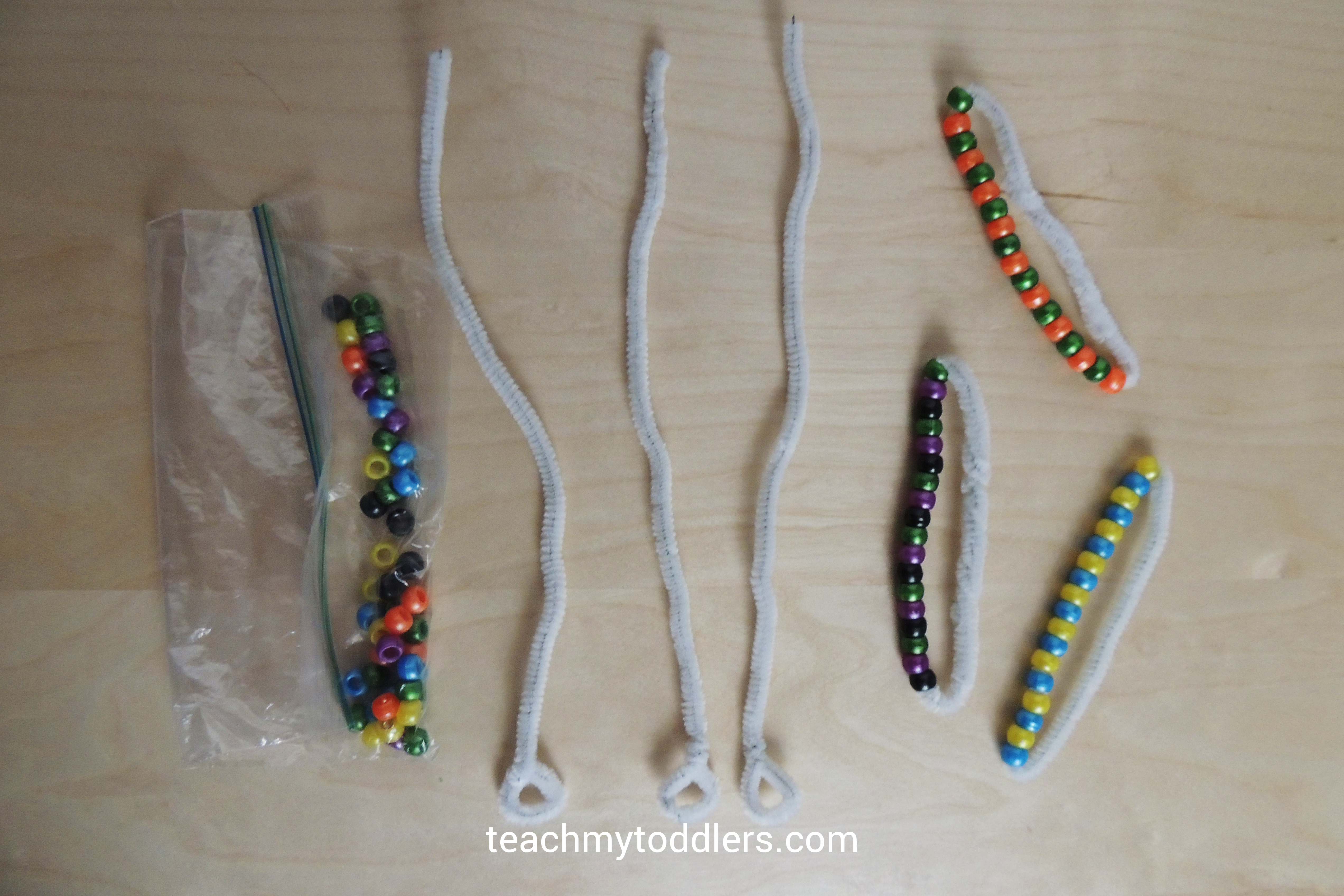 Create patterns with pipe cleaners and pony beads for your toddler to play with during General Conference