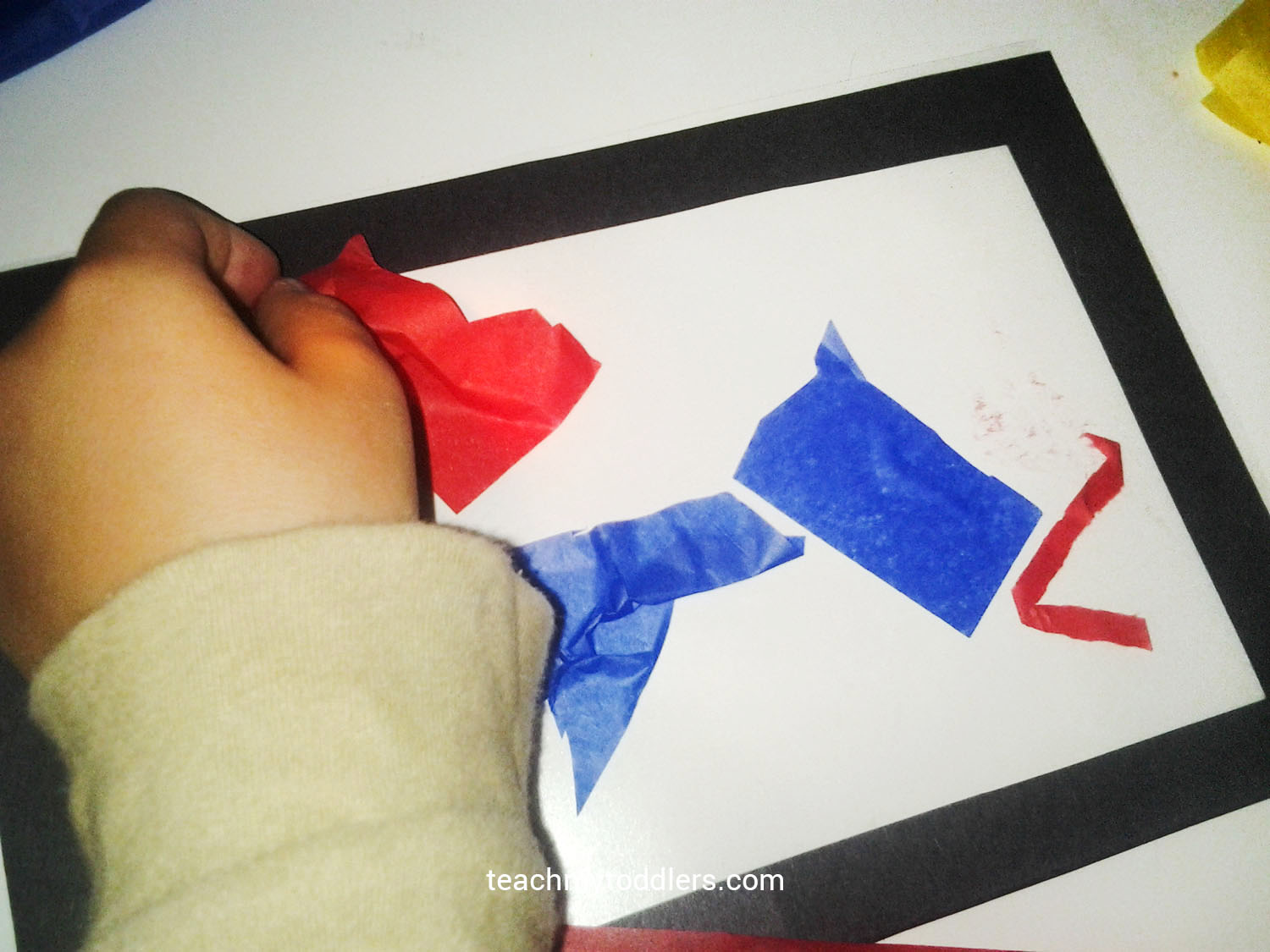 Your toddler will add paper to create stained glass shapes to their window