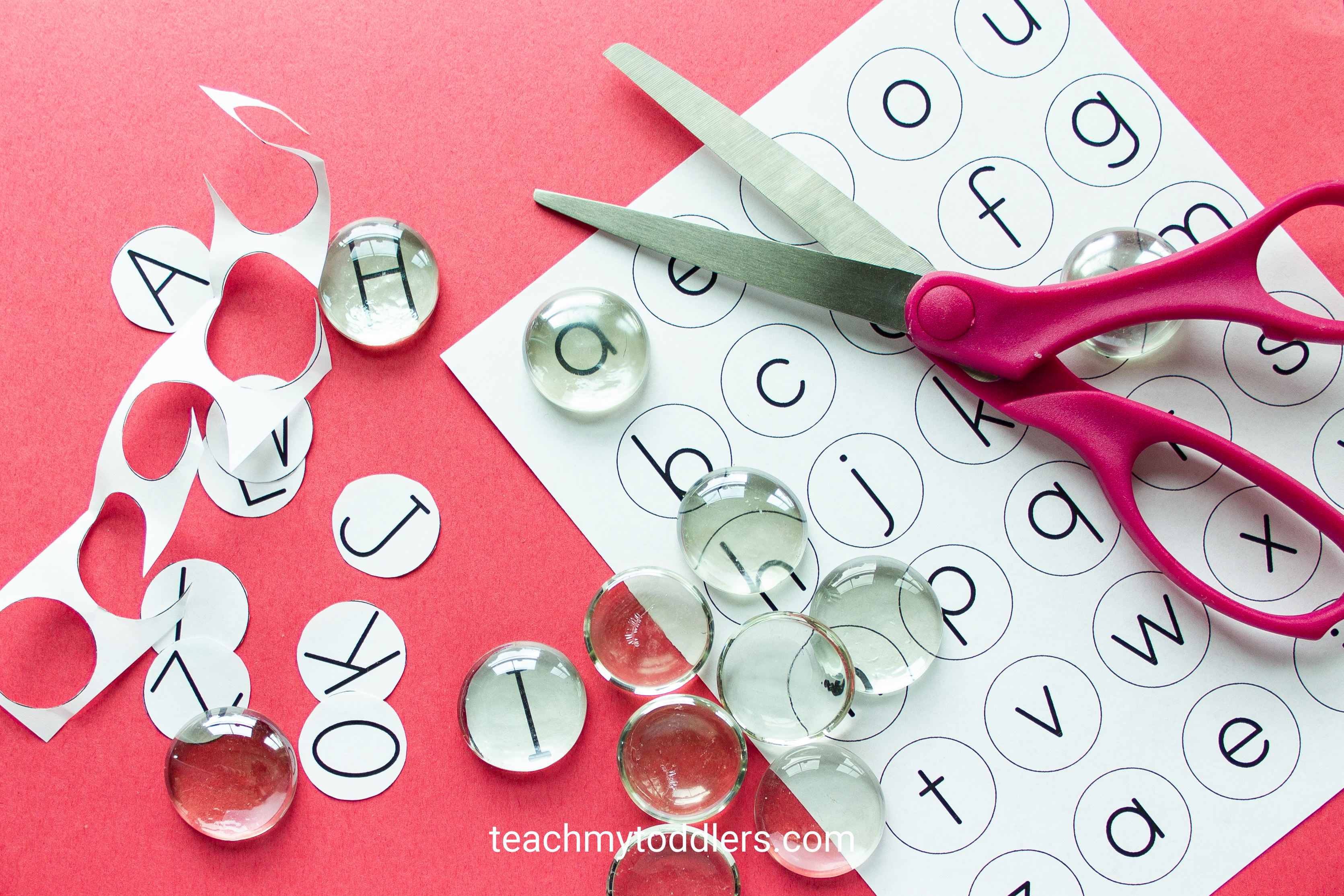 Teach your toddlers letters with this fun flat marble alphabet game