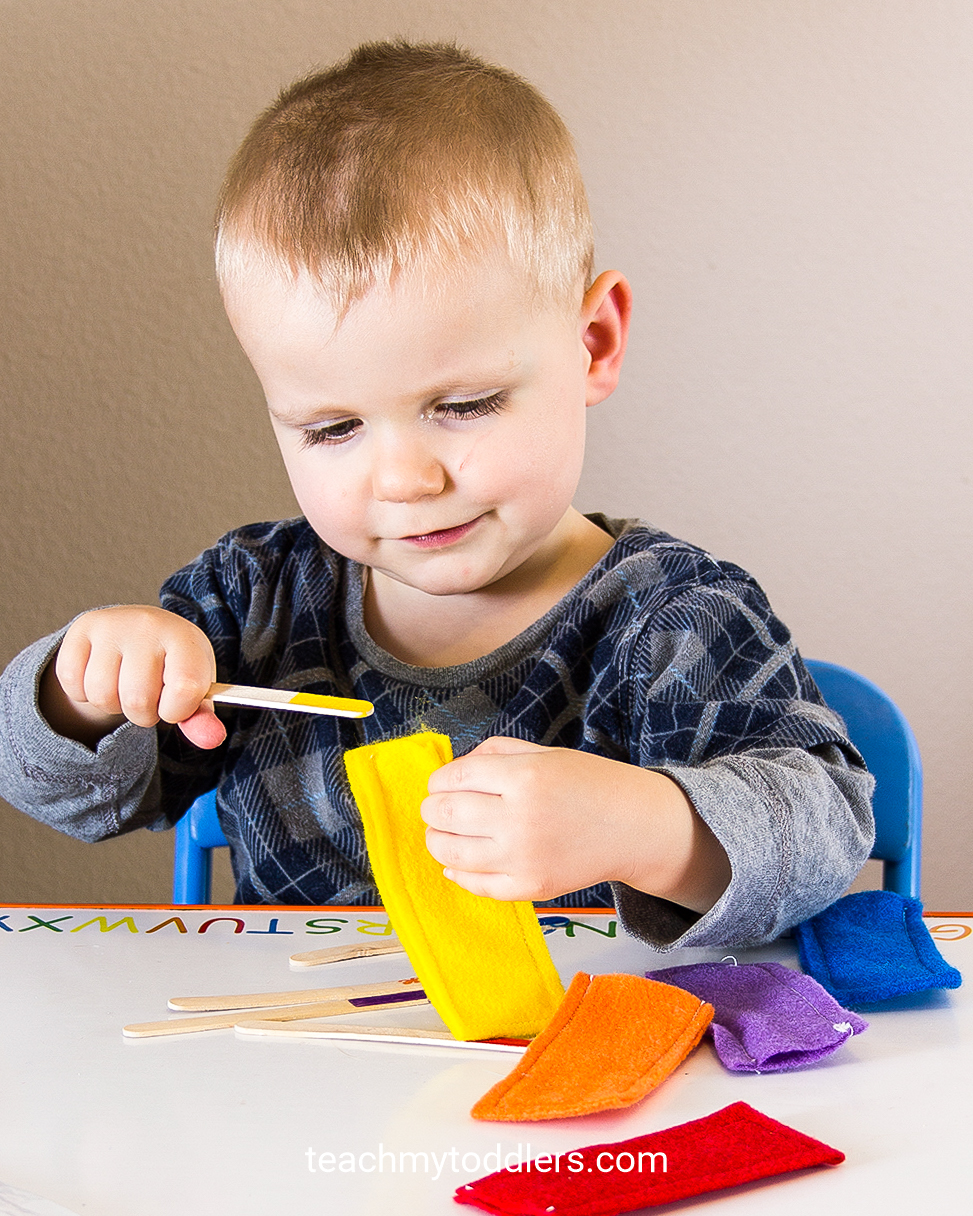 Discover how this color matching game to teach toddlers colors using popsicle sticks