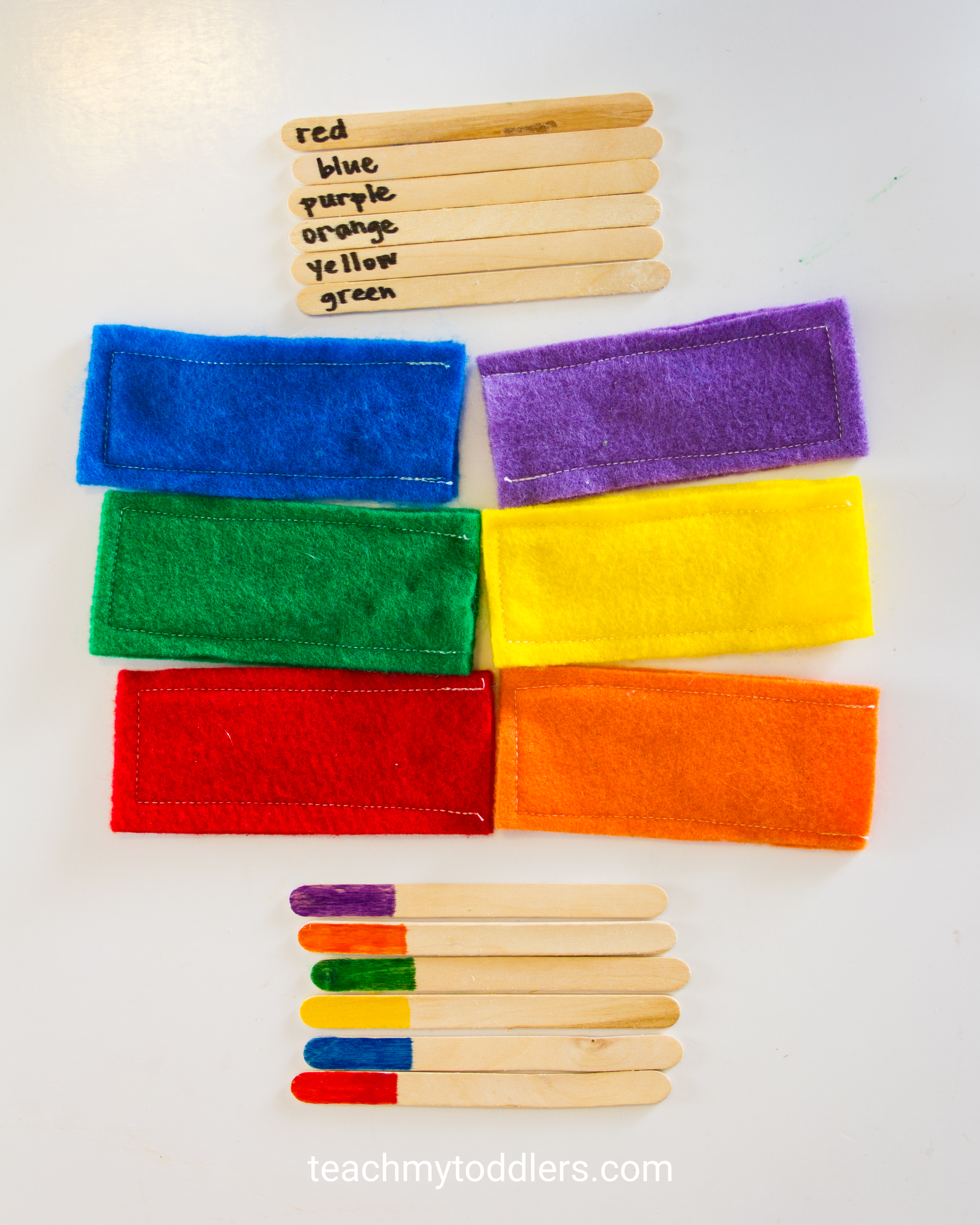 Discover how this color matching game to teach your toddlers colors using popsicle sticks