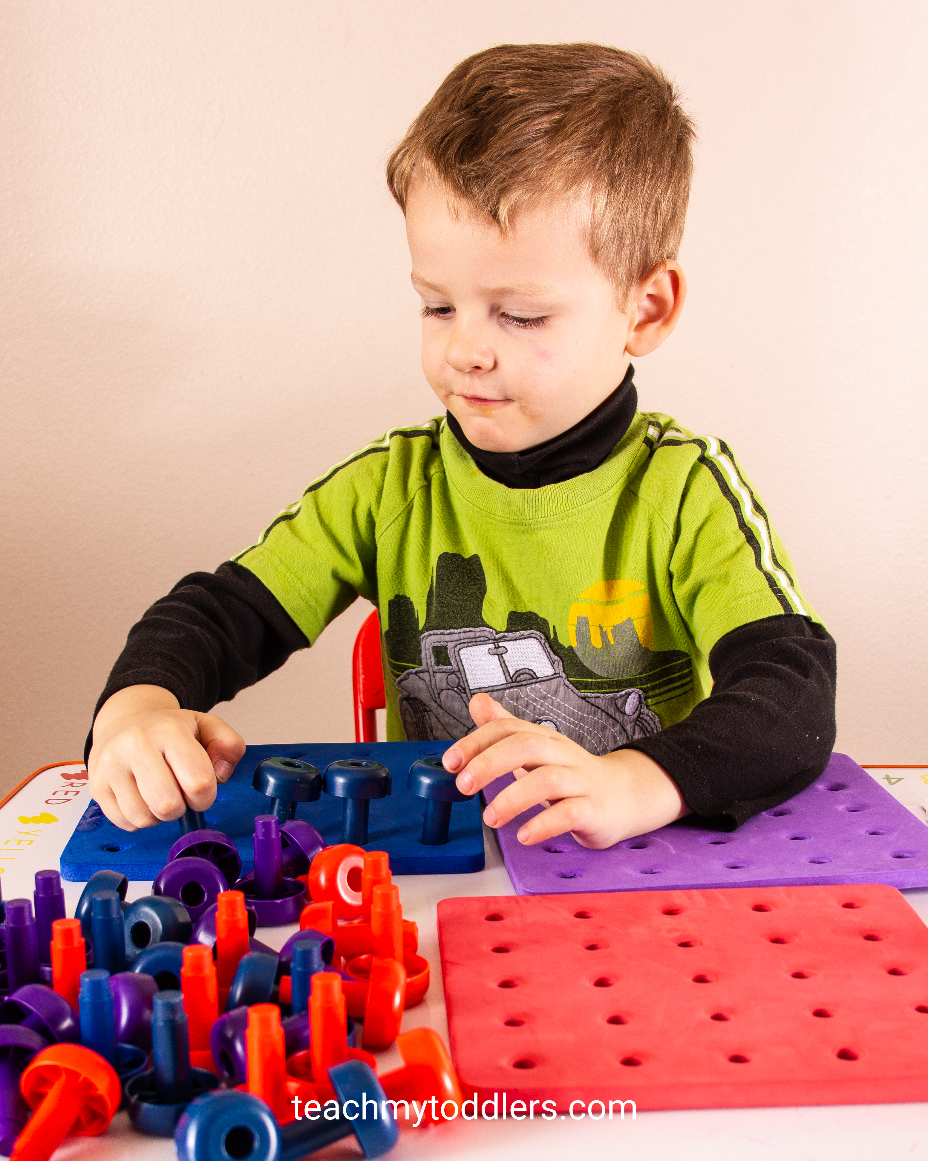 Preschool ages can learn colors too with these peg boards and pegs