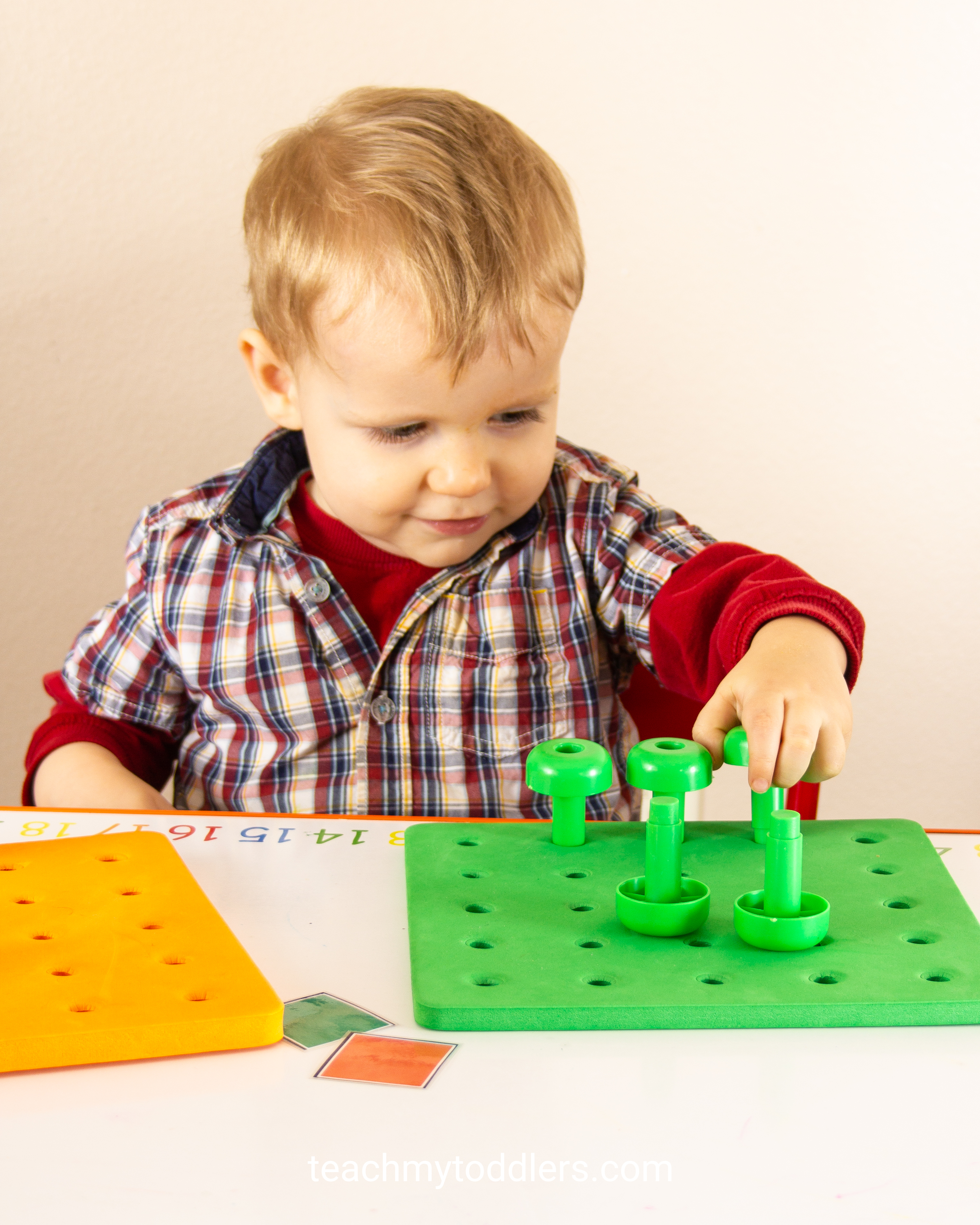 These pegs and peg boards will help teach your toddlers colors