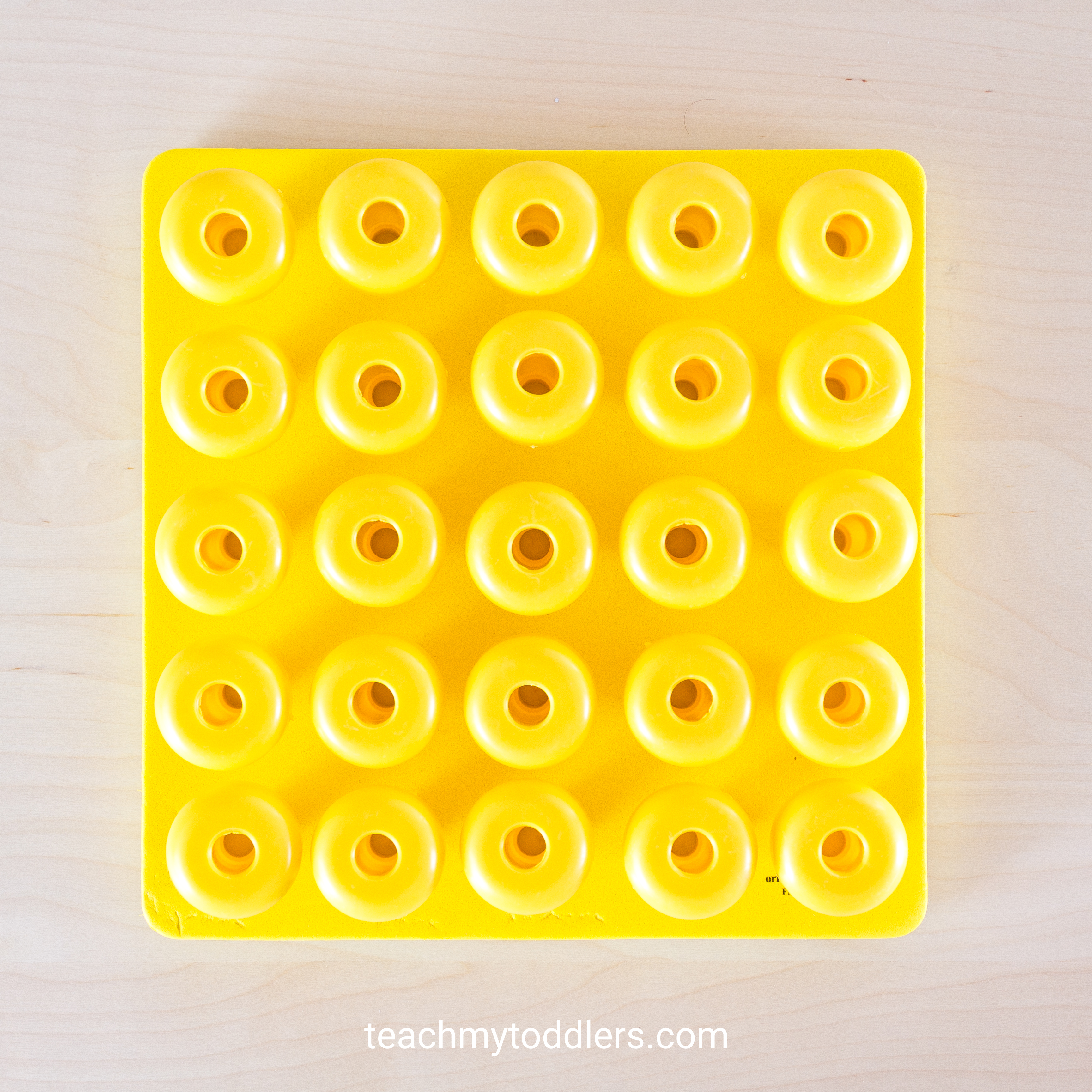 This yellow peg board can help your toddlers learn colors