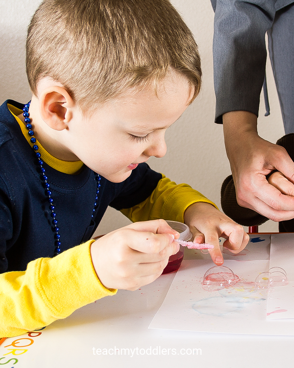 Learn how to use bubble painting to teach your toddlers colors