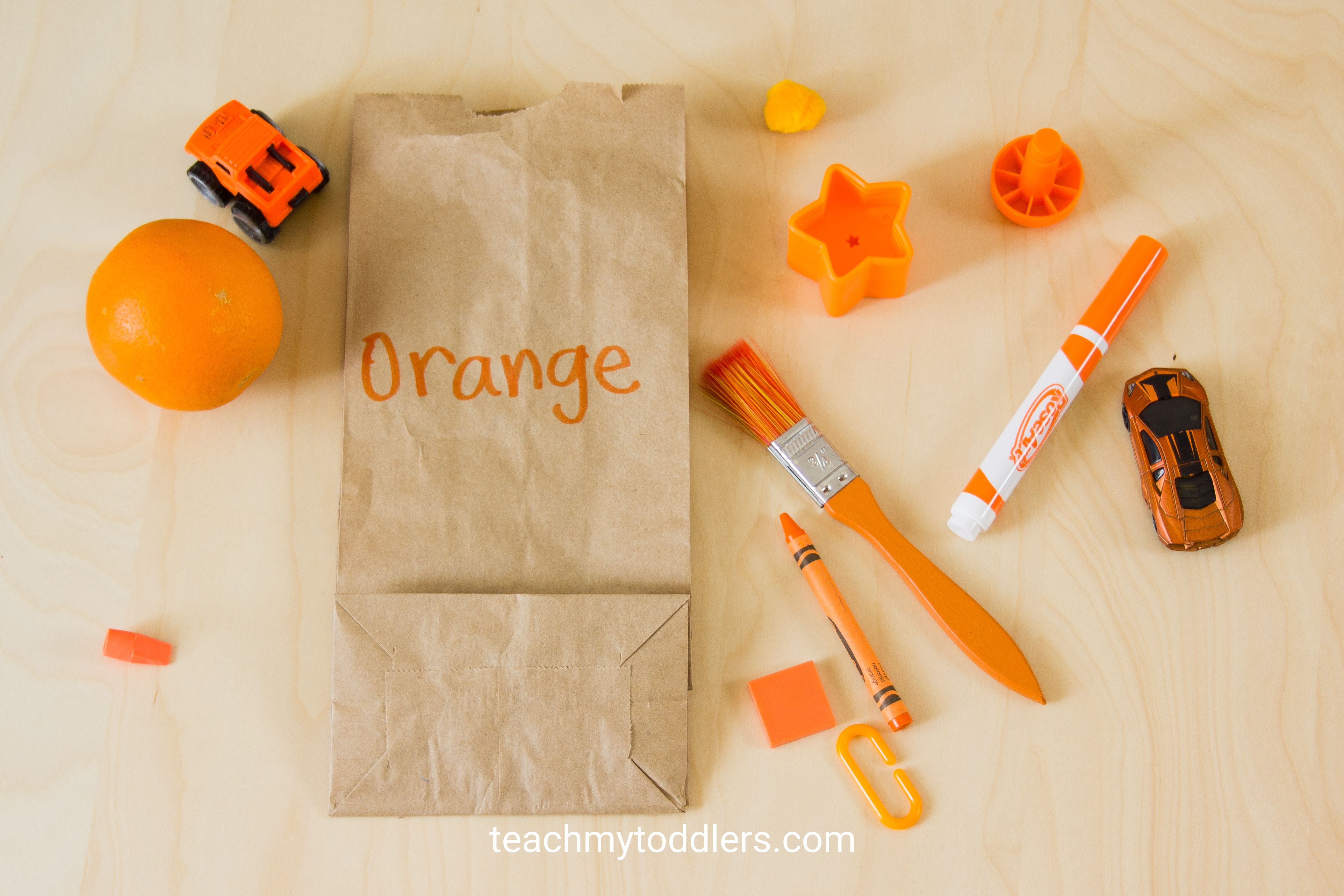 These orange pieces are a great example for the color scavenger hunt to teach toddlers colors