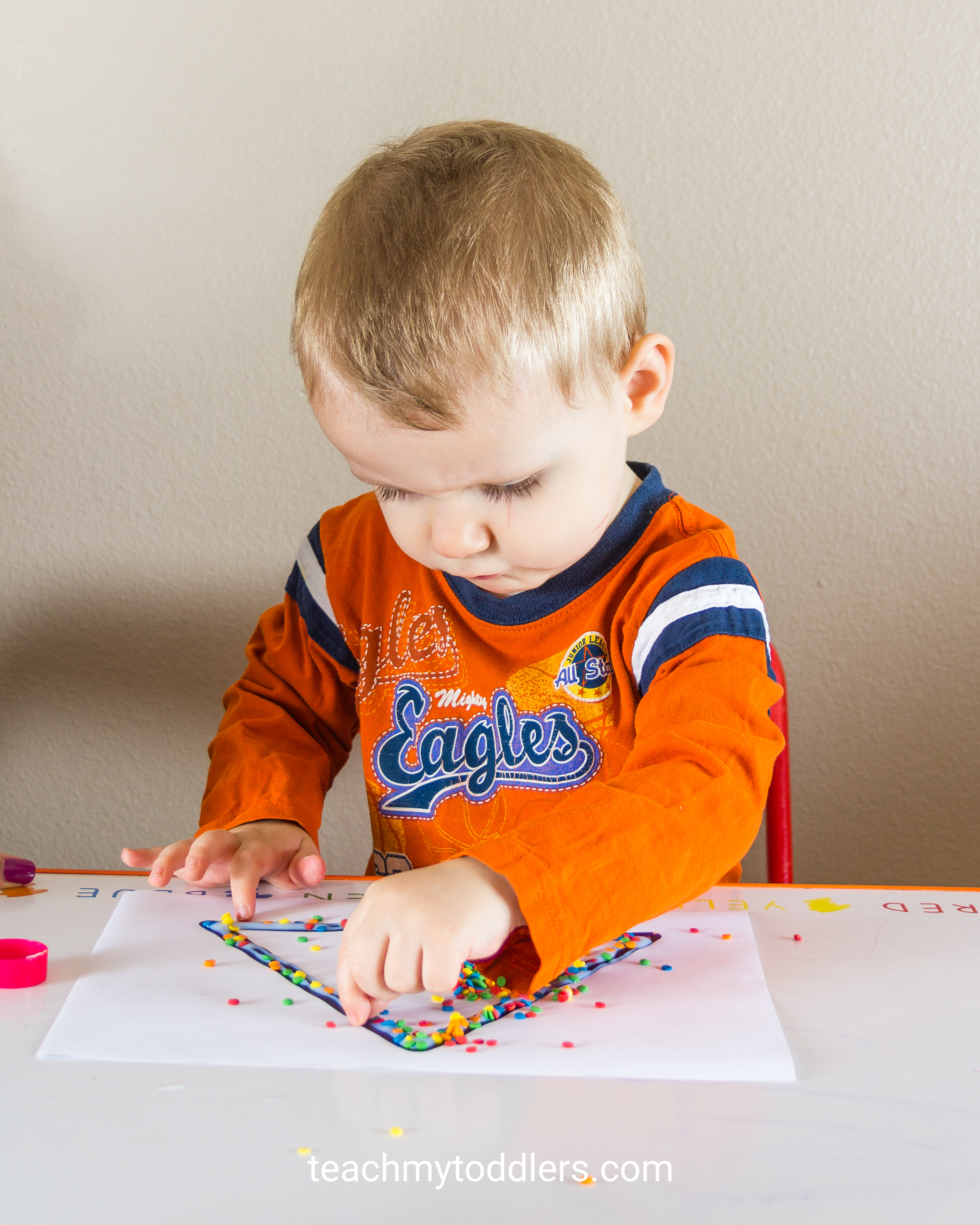 Discover how to use this decorating shapes activity to teach toddlers shapes