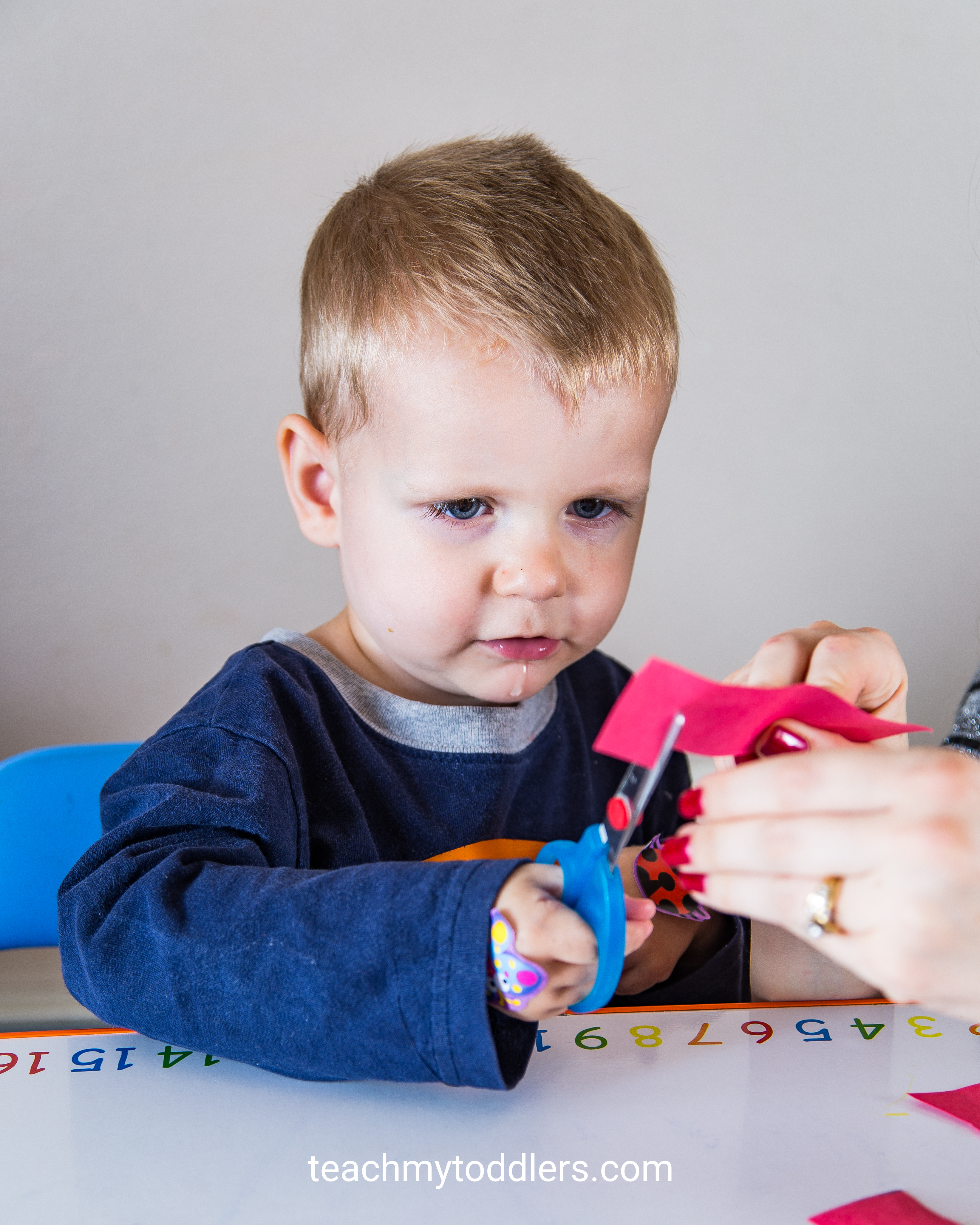 Use this fun cutting practice to teach your toddlers shapes