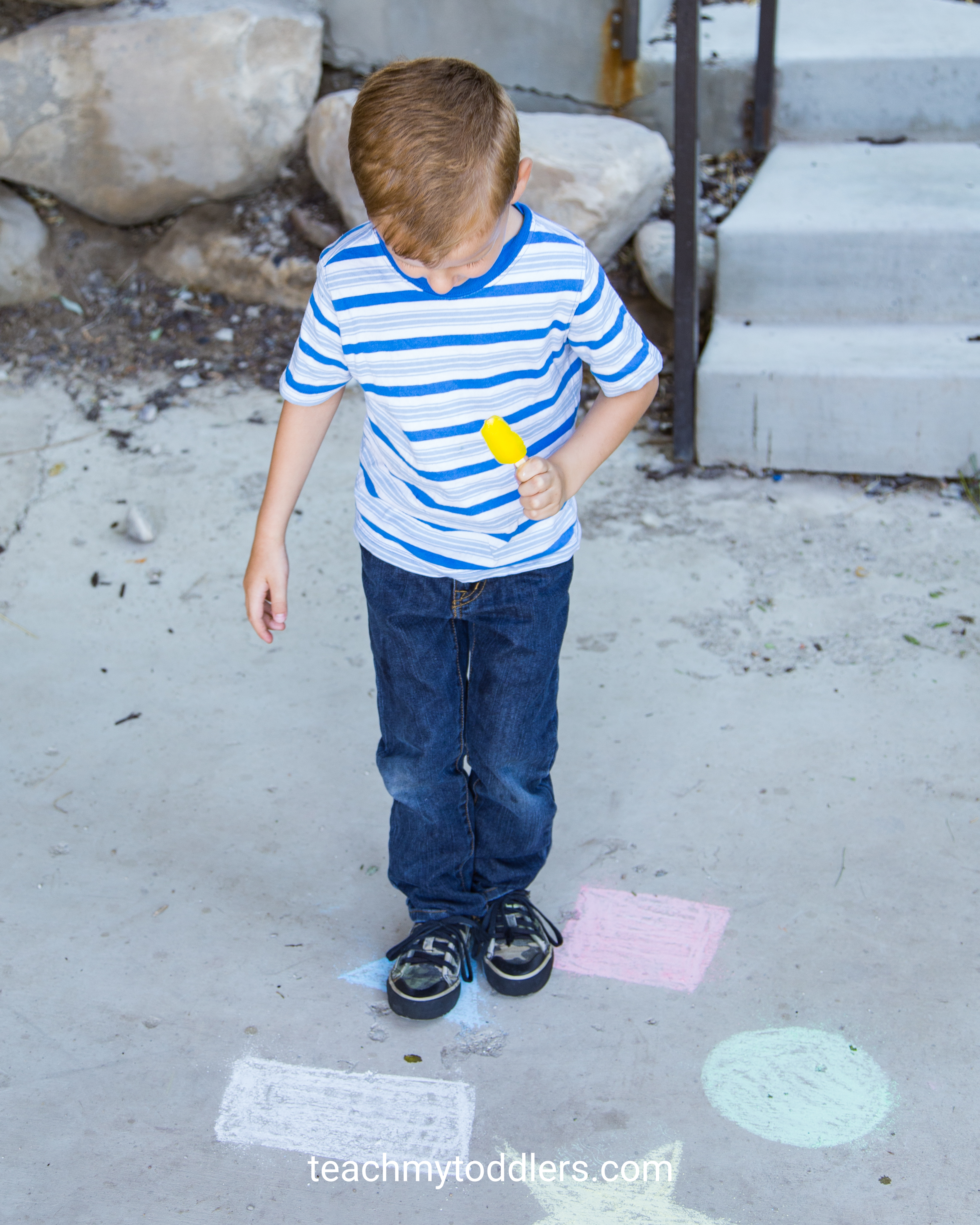 Use this fun activity to teach your toddlers gross motor skills by jumping on chalk shapes