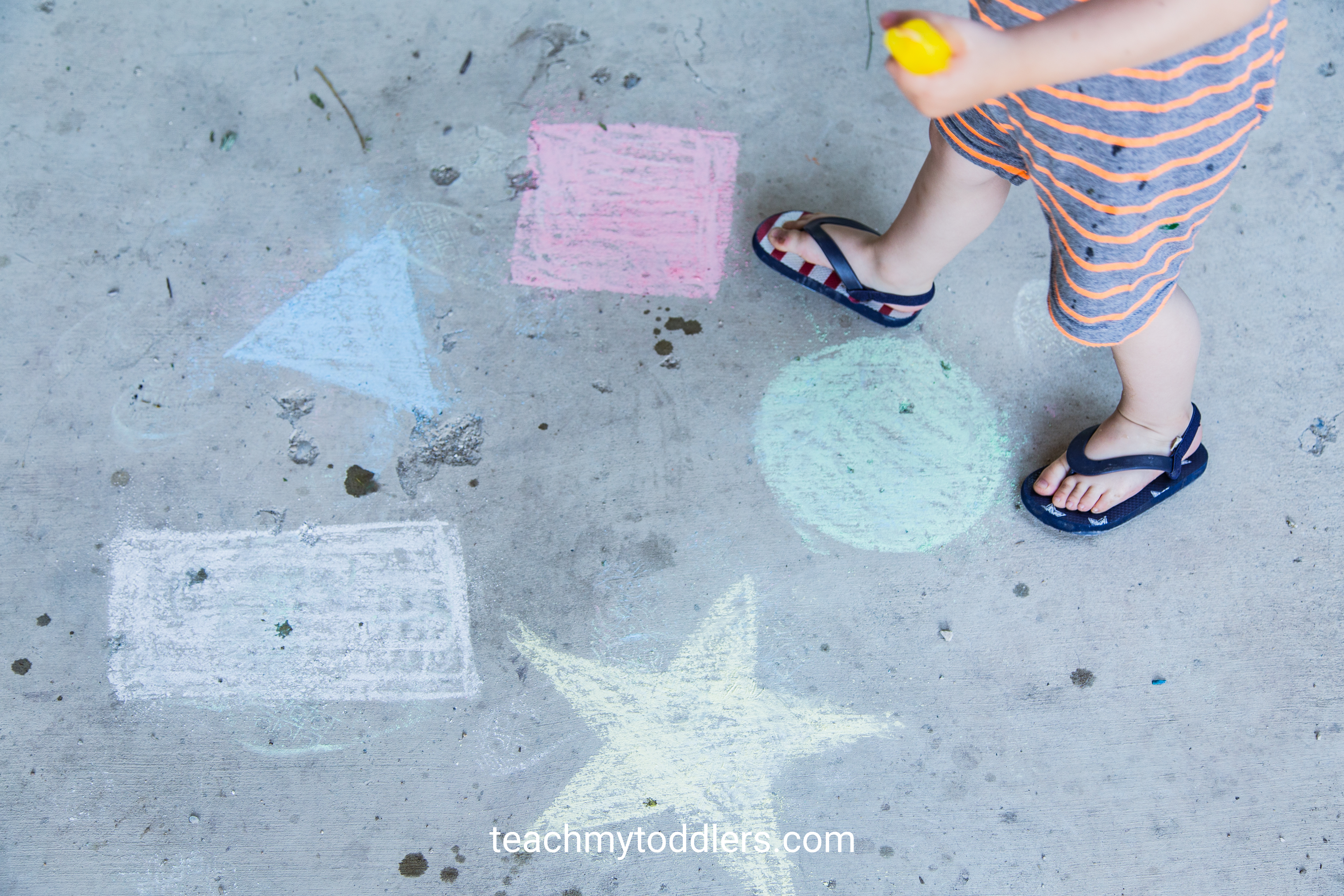 Use this fun idea to teach your toddlers gross motor skills by jumping on chalk shapes
