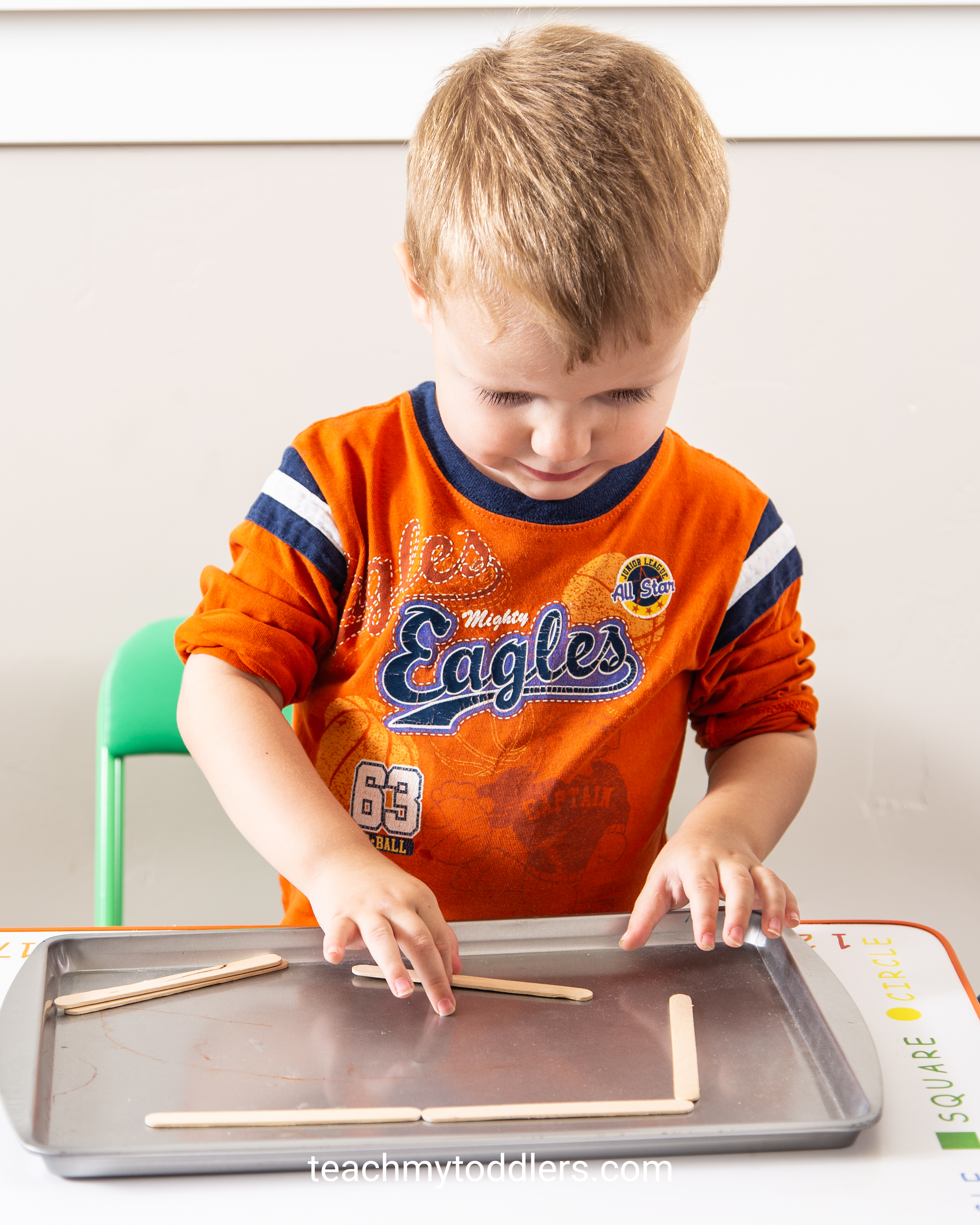 Use these fun rectangle trays activities to teach toddlers shapes