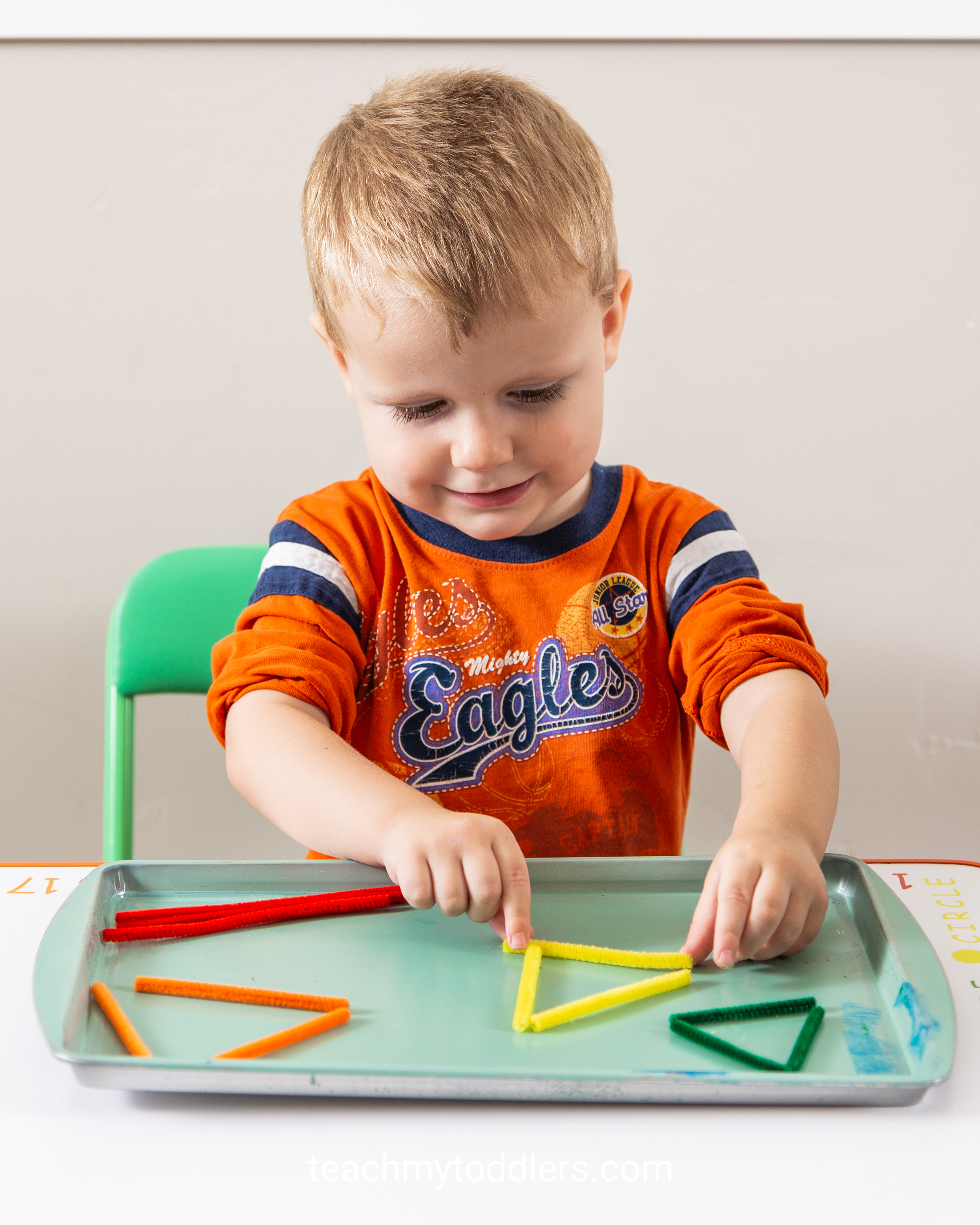 Use these great triangle trays to teach toddlers shapes