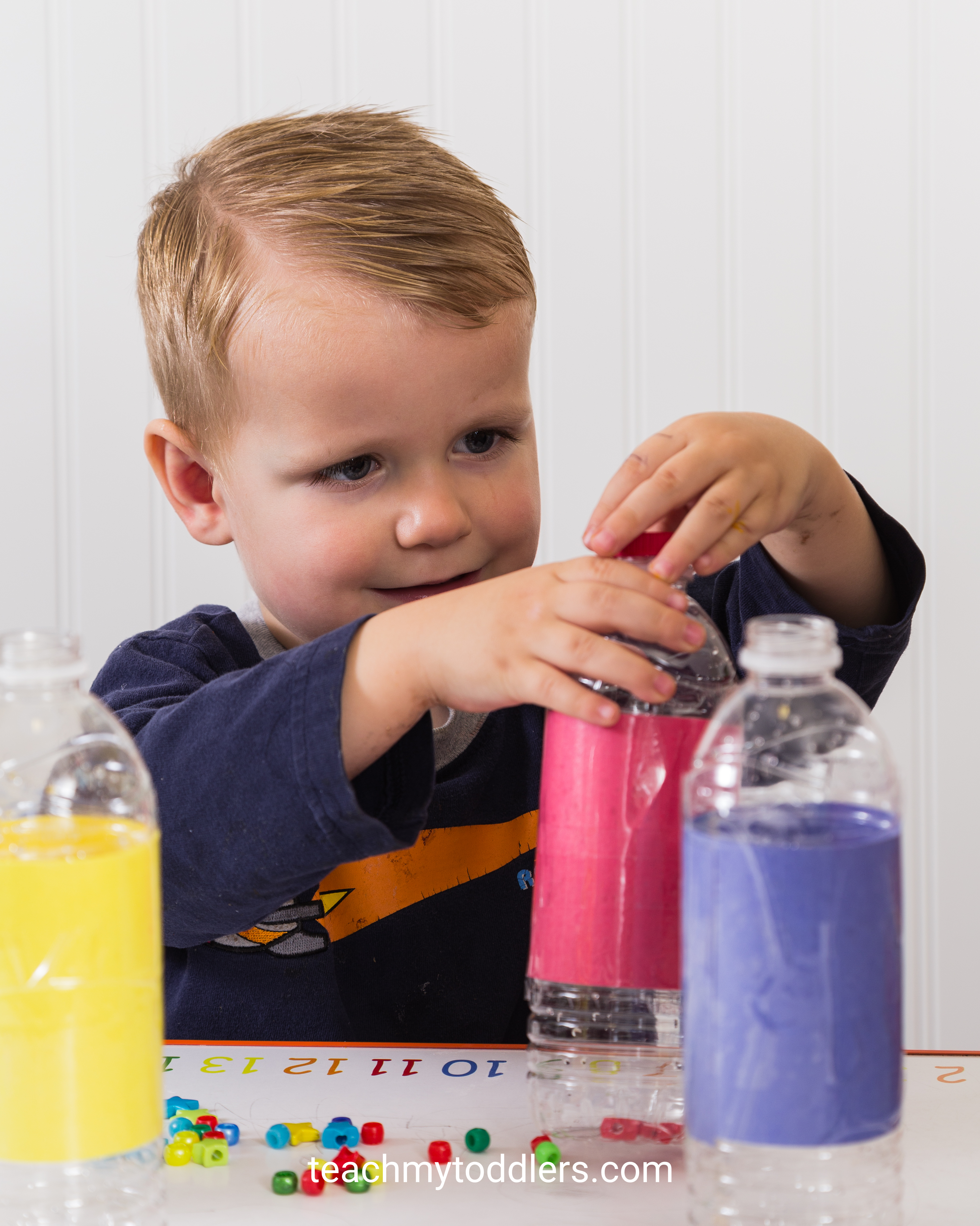 A fun activity to teach your toddlers colors using beads and water bottles