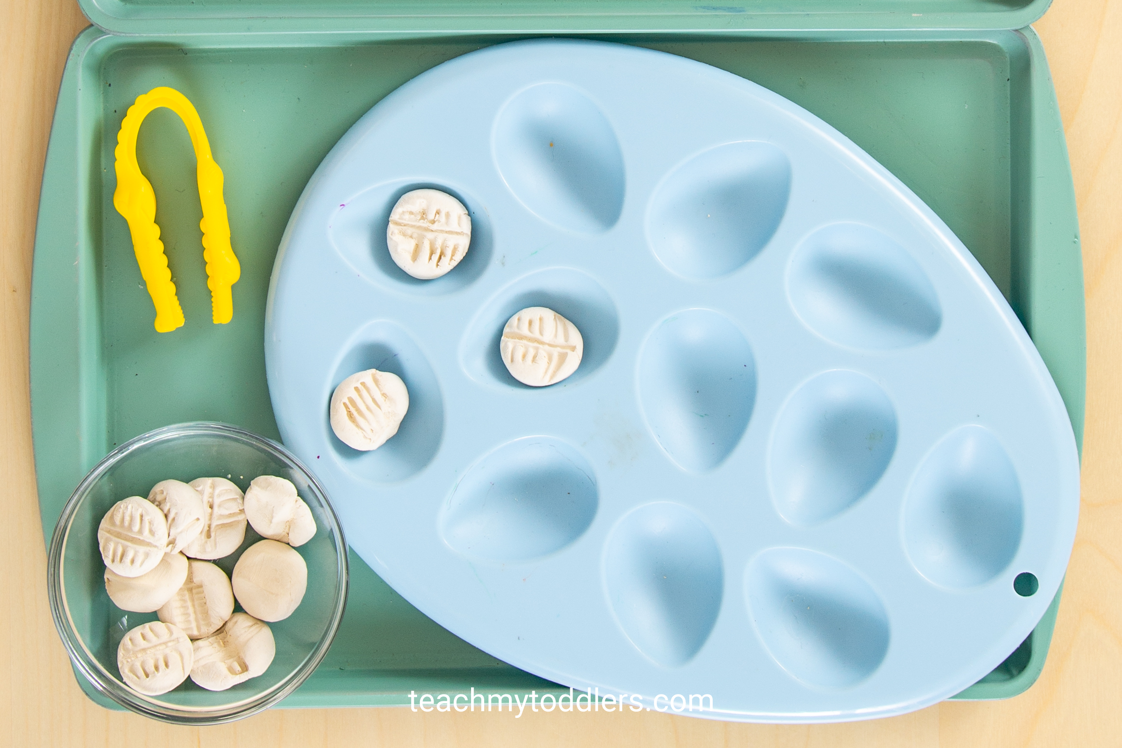 These toddler trays are exciting for teaching toddler the letter e is for extinct