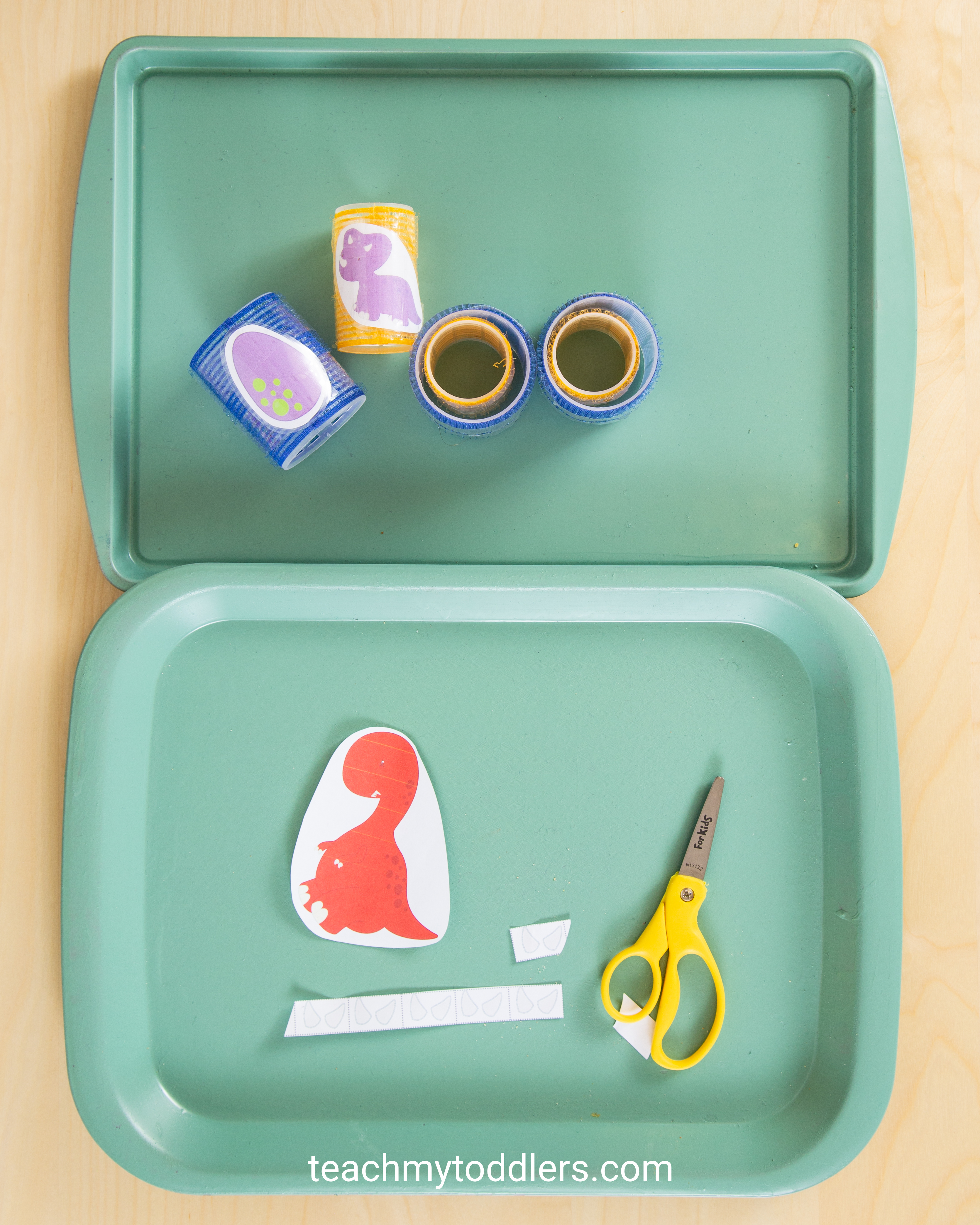 These toddler trays are unique for teaching toddler the letter e is for extinct