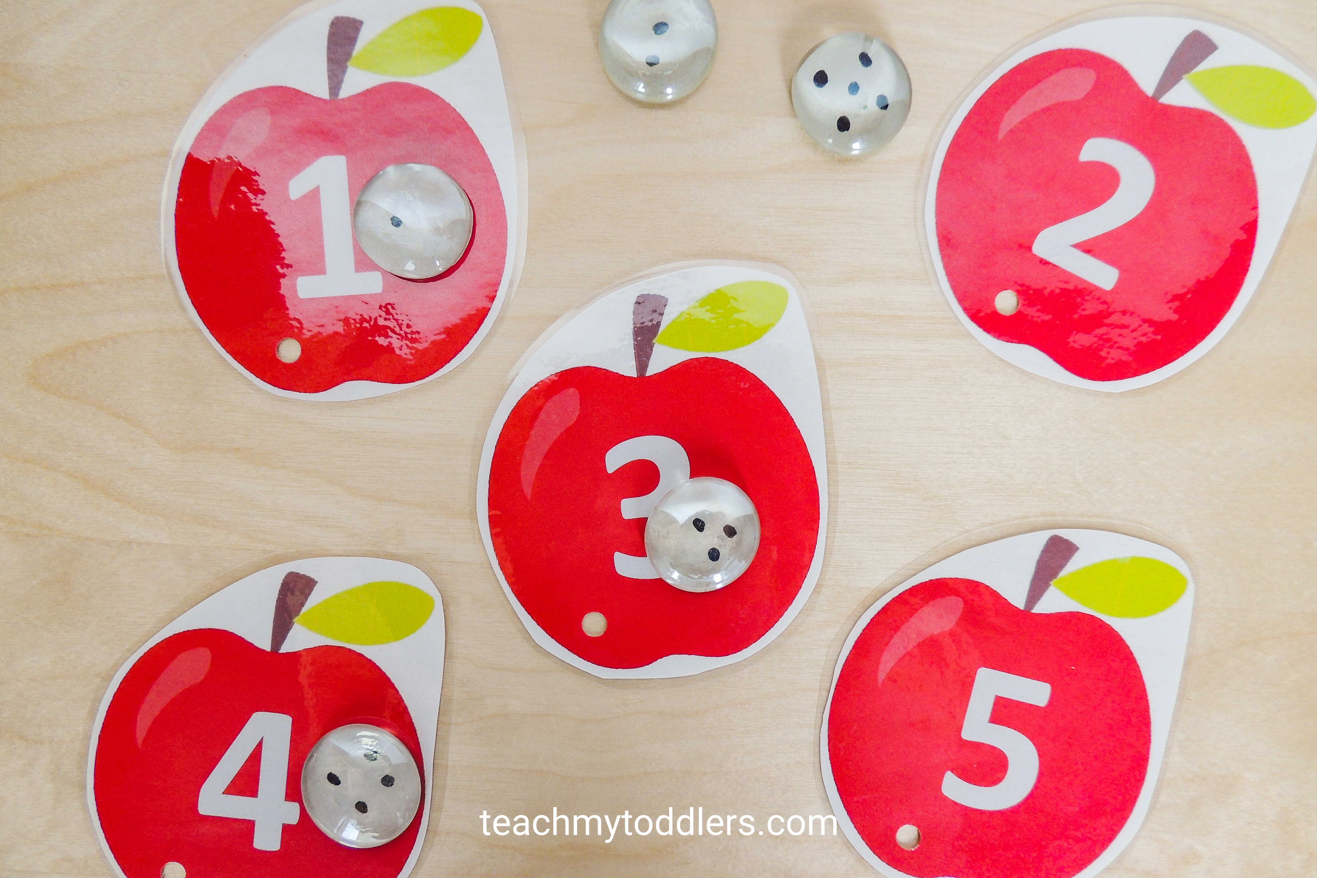 Use these unique clip cards to teach your toddlers numbers